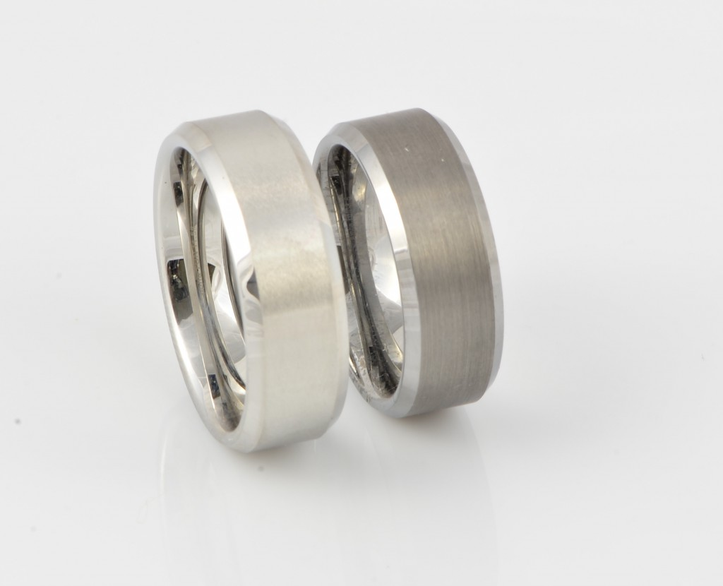 On the left is a Cobalt ring with a brushed face, on the right is a Tungsten ring with a brushed face